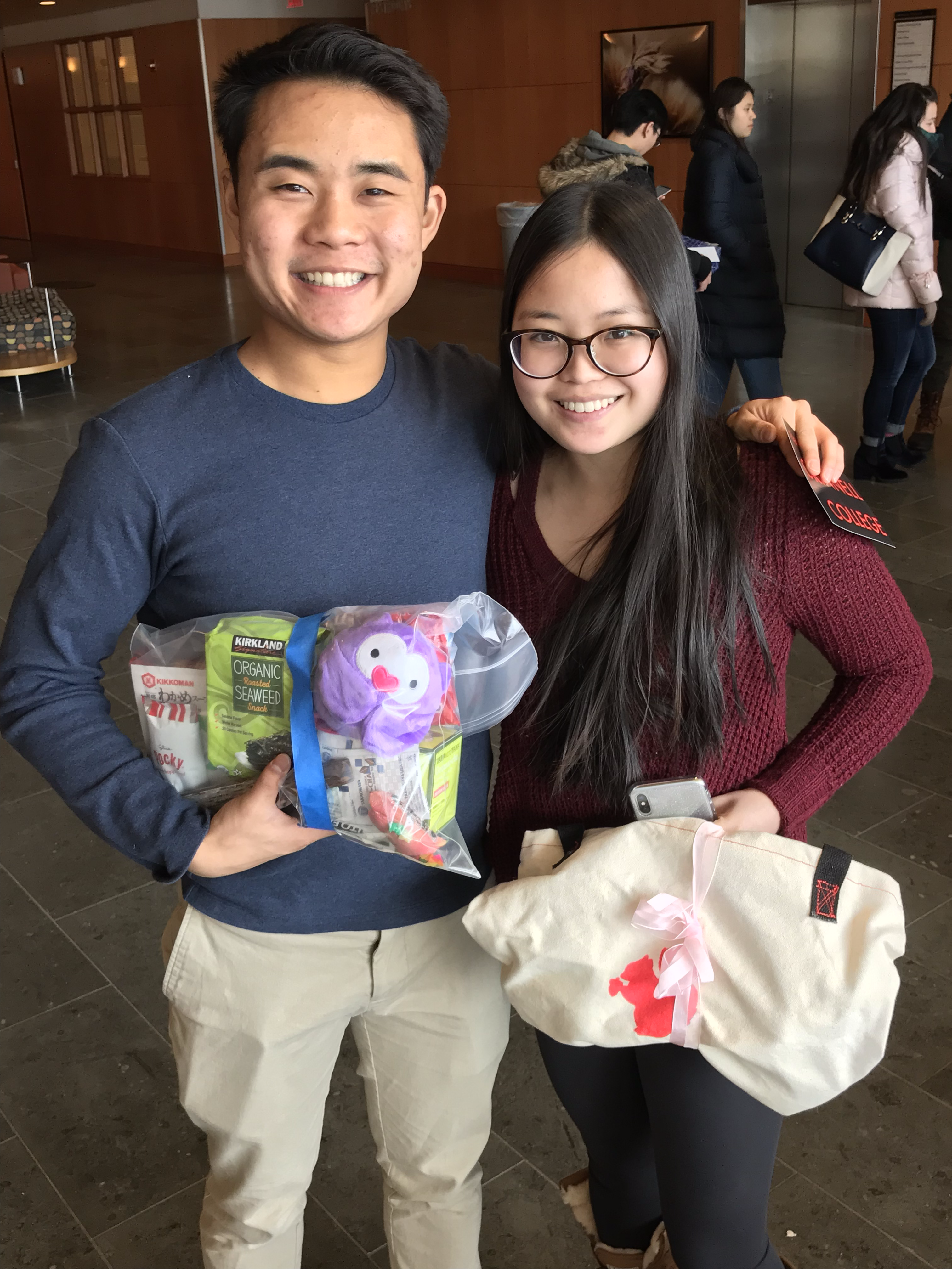 Bryce Lew '19 and Dana Watkiss '19 show off their own care packages